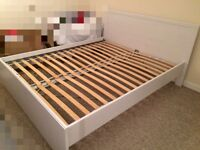 White wooden double bed and mattress
