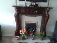 Solid wooden fireplace surroundImg in excellent condition. Includes marble behind.