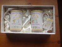Golden wedding anniversary cups/mugs.