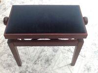 Dark wood piano stool