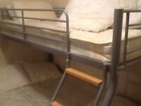 Triple sleeper bunk beds complete with mattresses.