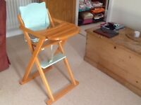 Wooden high chair hardly used. Very good condition