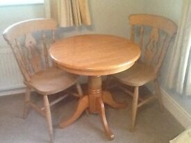 PINE TABLE AND TWO MATCHING CHAIRS