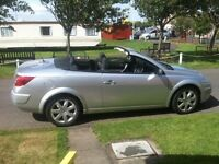 Megane convertable 1.5 DCi practical convertable all year round.
