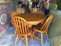 Kentucky oak circular extendable dining table and six chairs