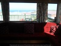 FULLY EQUIPPED TWO BEDROOM 6/7 BERTH CARAVAN WITH ENCLOSED DECKING TO LET, PERRANPORTH, CORNWALL