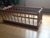 "Wooden crib measures 36""x20""x15"" high"