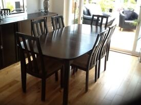 Dark oak extending dining room table and 6 chairs