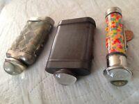 Three vintage bullseye torches.