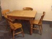 Pine table with drawer and 4 Ash wood chairs