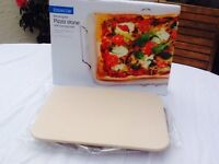 RECTANGULAR PIZZA STONE WITH SERVING RACK. BRAND NEW. NEVER USED. IN BOX