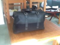 Riass Holdall black leather with cloth inserts