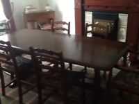 Dining table and chairs, two carvers. A bit of wear but nothing noticable hence price £50