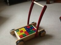Hardly used wooden baby walker
