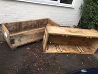 Two large solid wooden planters