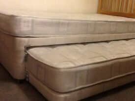Single divan bed with rollout guest bed and oak headboard
