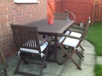 Large wooden garden table & 5 folding chairs £50