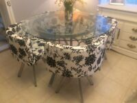 lovely modern round glass table and x4 modern black and white chairs