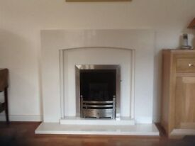 Portland stone fireplace plus Enigma 2 S/C Pebble NG gas fire in very good condition