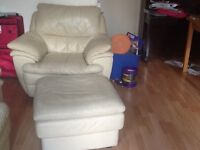 2 cream leather armchairs and footstool.