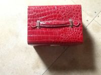 Red vanity bag, ideal for travelling, for make up and jewellery