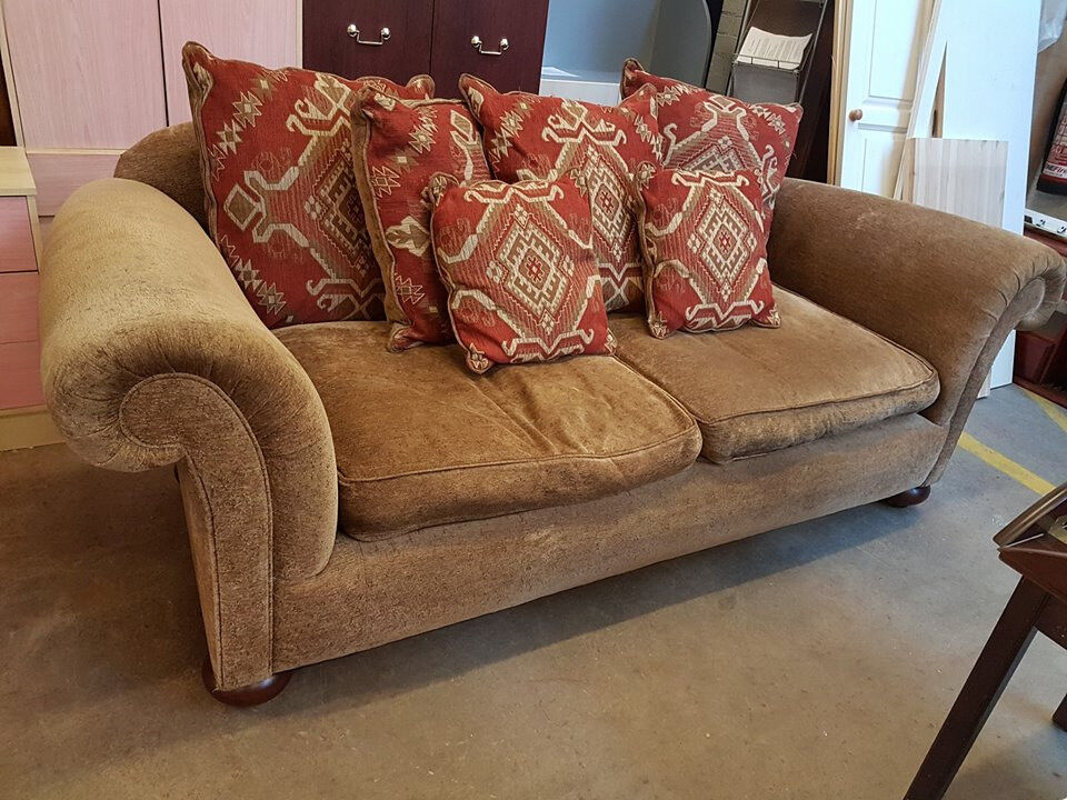 Brown fabric two seater sofa with cushions