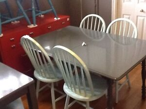 Large wood grey table with 4 blue chairs
