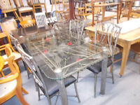 WROUGHT IRON AND GLASS DINING TABLE AND CHAIRS