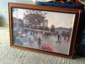 Framed landscape print with glass.
