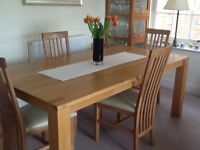 American solid light oak dining table in immaculate condition, give away price £125