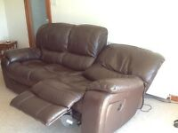 Leather suite. Three seater and two seater with electric recliners. New condition. Dark brown.