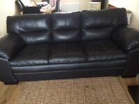 Black DFS Leather Sofa in good condition just over a year old selling due to house move