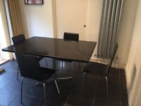 BLACK GRANITE TABLE and LEATHER chairs.