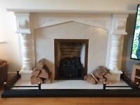 Painted solid wooden fireplace surround plus fire back and tiled hearth with black steel bumper.