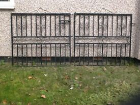 Pair wrought iron gates to fit 2.6m (8.75 ft) opening, each 1.27m (50in) wide x 1.17m (46in) high.