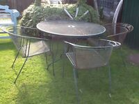Wrought iron garden table and chairs
