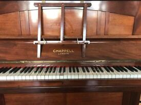 Chappell Piano. Needs tuning and one key damaged. Beautiful piece of furniture and lovely sound.