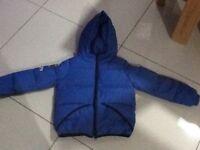 Boys blue Benetton puffa jacket - 5-6 years