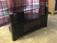 TV corner stand, black glass, with useful storage area.
