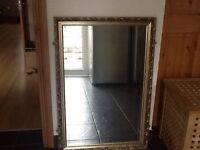 Large mirror in a carved frame
