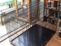 Large metal dog crate suitable for any breed of dog