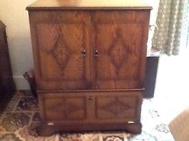 Light oak TV cabinet.
