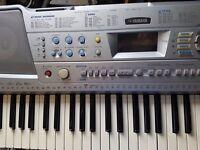 Yamaha keyboard good condition + stand & plug