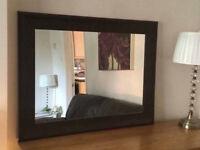 Mirror with dark brown leather effect surround