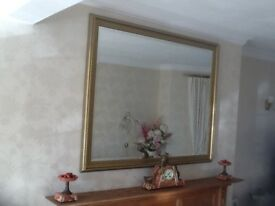 Large mirror in a wooden frame gold guilt in good condition