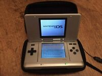 Nintendo DS with chargers, accessories and 5 original cased games.