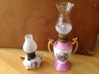 Two decorative oil lamps.