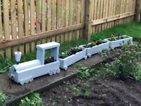 Fully treated train planter come natural colour not blue like picture