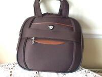 Brown Aerolite hand luggage bag