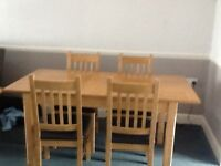 Dinning table and chairs light oak is extendable only two years old.size 120cm length x80cm wide.
